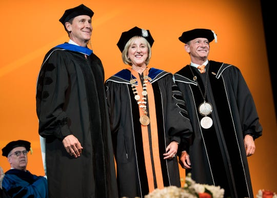University of Tennessee Chancellor Donde Plowman, center, poses for photos with UT Board of Trustees Chair John Compton, left, and interim UT System President Randy Boyd during the investiture at the UT Student Union Auditorium on Wednesday, Nov. 6, 2019.