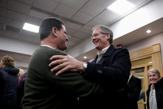 Lafayette Mayor Tony Roswarski and West Lafayette Mayor John Dennis embrace each other after winning re-elections in their cities, Tuesday, Nov. 5, 2019 at Tippecanoe County Building in Lafayette.