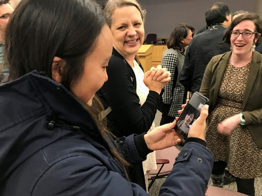 Shannon Kang, left, engages in a FaceTime call with her mother after winning election for West Lafayette City Council District 3 as Lisa Dullum, center, and Ilana Stonebraker watch on, Nov. 5, 2019 at Tippecanoe County Building in Lafayette.