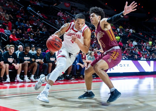 Redshirt freshman Kobe Julien drives to the basket in UL's season-opening win over Loyola of New Orleans on Tuesday night.
