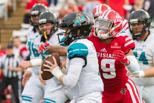 UL cornerback Eric Garror sacks Coastal Carolina quarterback Bryce Carpenter in a 2018 game at Cajun Field.