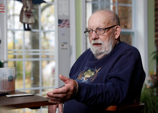 Bernard Paumier talks about his experience in the Air Force and his tutoring of immigrants to help them pass citizenship tests Thursday, Oct. 31, 2019, at his home near Baltimore.