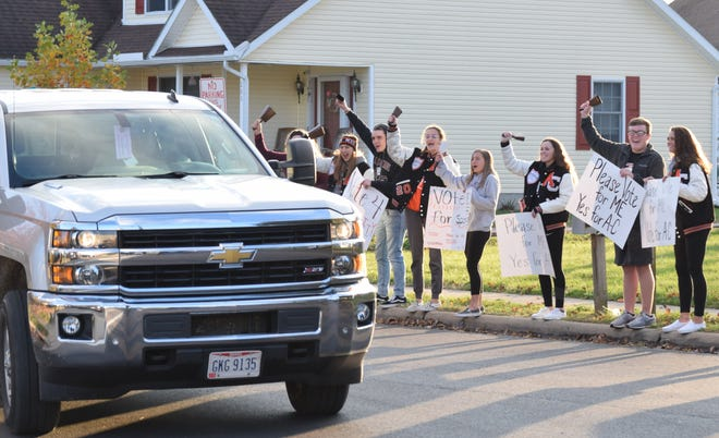Amanda-Clearcreek students cheer as a driver honks their support for the proposed income tax levy. If the initiative should fail, the school district will be forced to cut extra- and co-curriculars, which would mean the end of everything from athletics to FFA to AP classes.