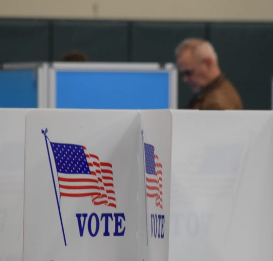 Steve Lyall, background, casts his ballot during the Nov. 5 election at Crossroads Ministry Center in Lancaster. Fairfield County Board of Elections Director Jane Hanley reported no major problems with voting on Election Day.