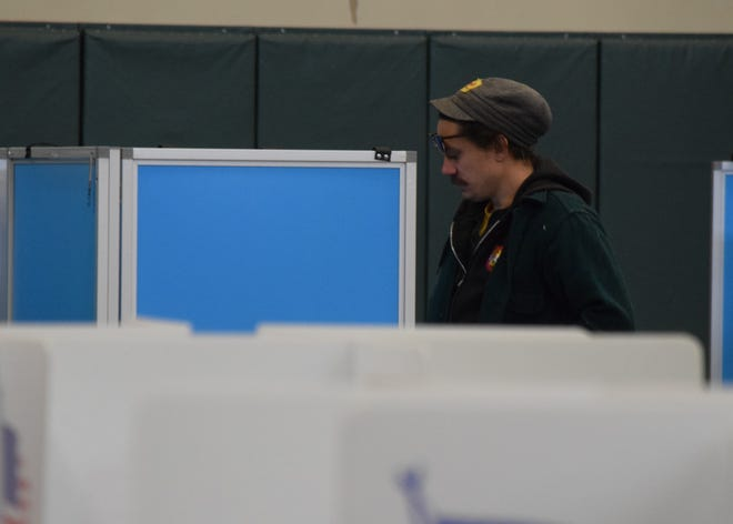 Martin Wolfgang Boyer stands at the polling booth during the Nov. 5 election at Crossroads Ministry Center in Lancaster.