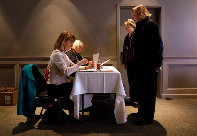 Margie Donnell, left, and Cheryl Barber check participants in for a Lancaster Fairfield County Chamber of Commerce Chamber Cafe event Wednesday, Nov. 6, 2019, at Ale House 1890 in downtown Lancaster. Donnell, the chamber's operations and marketing manager, for three years.