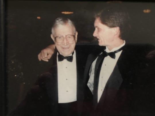 Bob Bronger shares a moment with legendary coach John Wooden