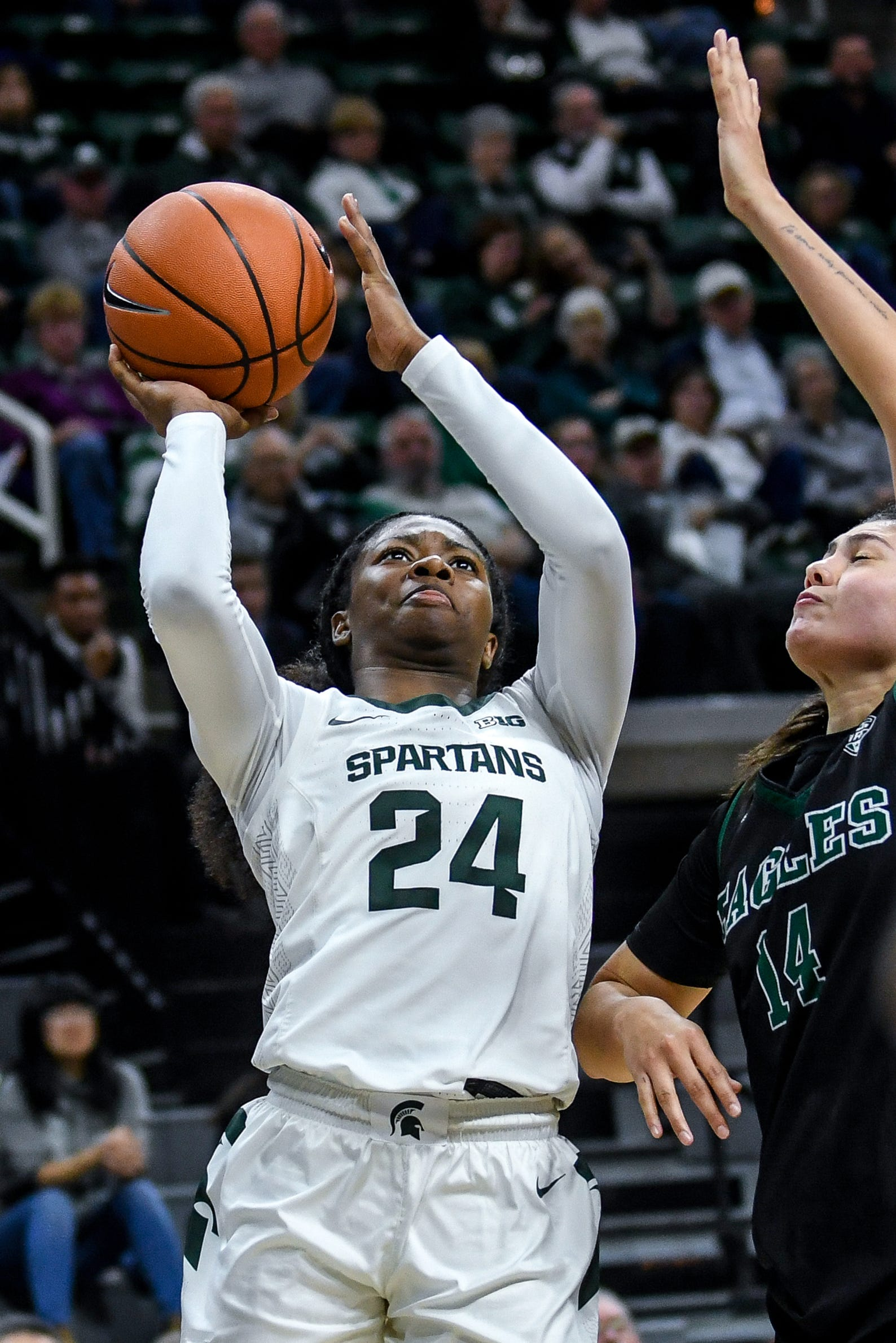 Michigan State's Nia Clouden, left, scores as Eastern Michigan's Natalia Pineda defends during the  fourth quarter on Tuesday, Nov. 5, 2019, at the Breslin Center in East Lansing.