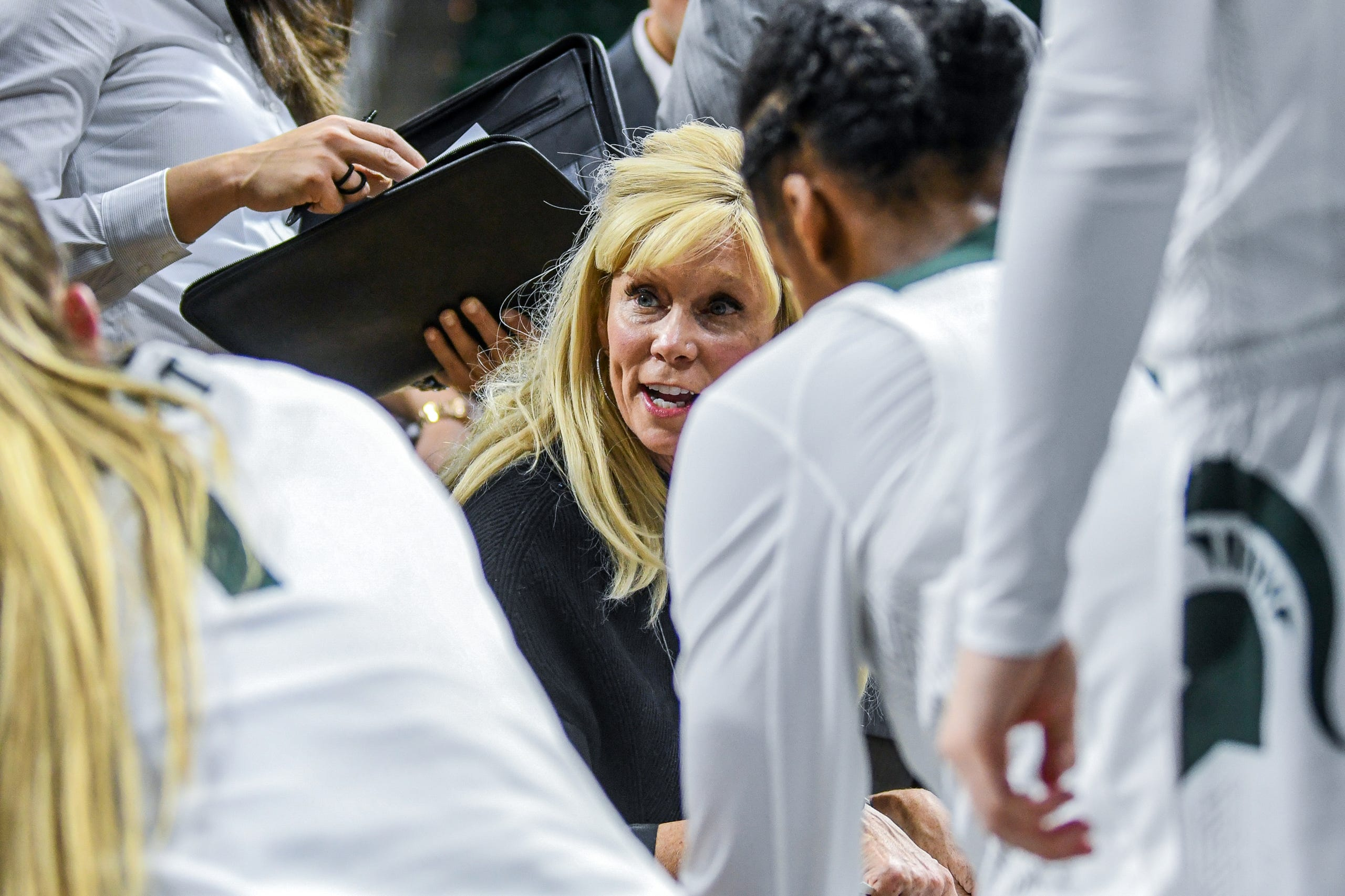 Michigan State's head coach Suzy Merchant talks with players during the second quarter on Tuesday, Nov. 5, 2019, at the Breslin Center in East Lansing.