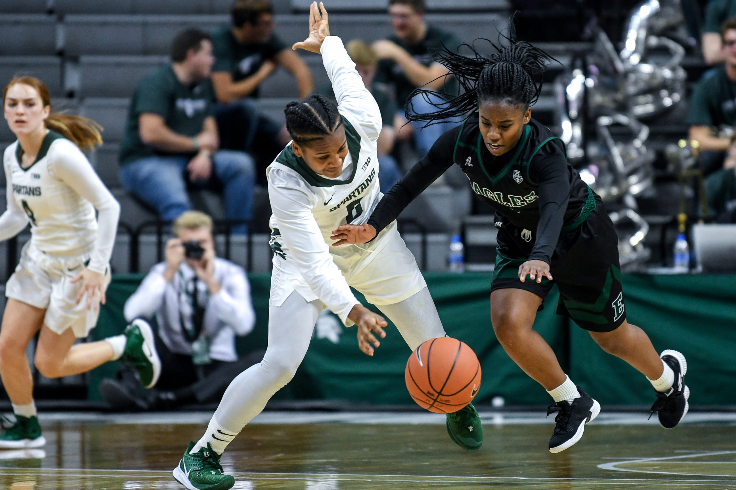 Michigan State's Shay Colley, left, is fouled by Eastern Michigan's Aaliyah Stanley during the fourth quarter on Tuesday, Nov. 5, 2019, at the Breslin Center in East Lansing.
