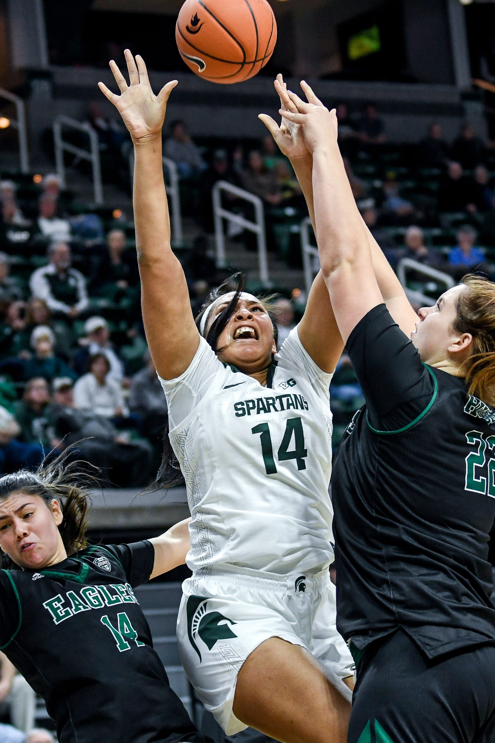 Michigan State's Taiyier Parks, center, shoots between Eastern Michigan's Natalia Pineda, left, and Autumn Hudson during the  fourth quarter on Tuesday, Nov. 5, 2019, at the Breslin Center in East Lansing.