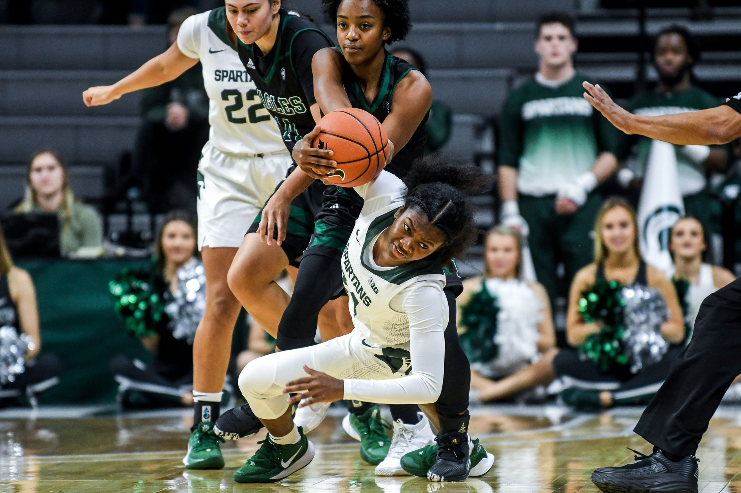 Michigan State's Nia Clouden, center, battles Eastern Michigan's Juanita Agosto, and JaBria Knight, left, for possession during the first quarter on Tuesday, Nov. 5, 2019, at the Breslin Center in East Lansing.