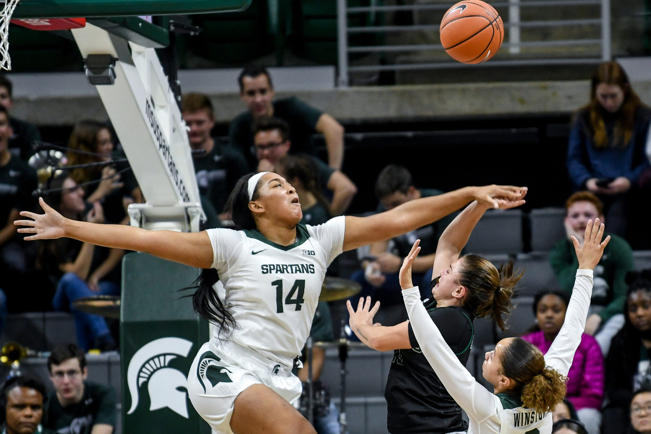 Michigan State's Taiyier Parks, left, blocks a shot Eastern Michigan's Jenna Annecchiarico during the third quarter on Tuesday, Nov. 5, 2019, at the Breslin Center in East Lansing.
