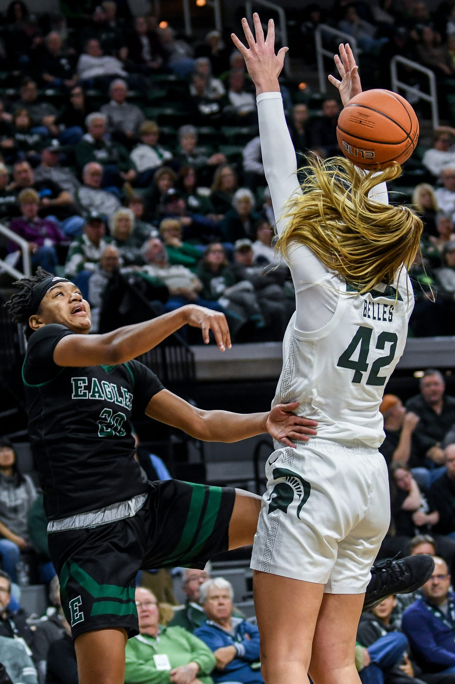 Michigan State's Kayla Belles, right, tips a pass made by Eastern Michigan's Corrione Cardwell during the  second quarter on Tuesday, Nov. 5, 2019, at the Breslin Center in East Lansing.
