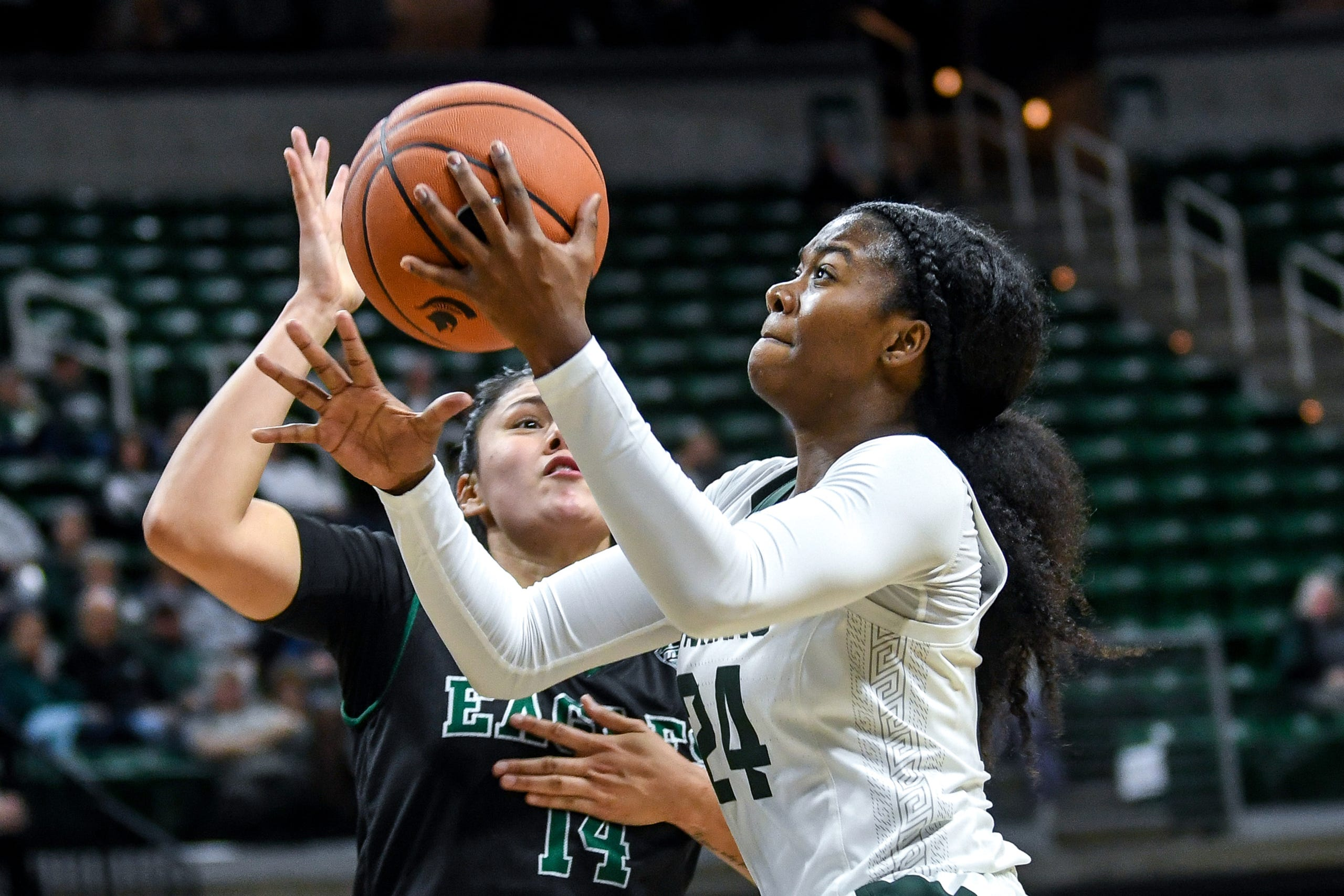 Michigan State's Nia Clouden, right, shoots a basket as Eastern Michigan's Natalia Pineda defends during the fourth quarter on Tuesday, Nov. 5, 2019, at the Breslin Center in East Lansing.