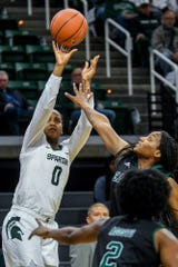 Michigan State's Shay Colley, left, shoots as Eastern Michigan's Courtnie Lewis defends during the first quarter on Tuesday, Nov. 5, 2019, at the Breslin Center in East Lansing.
