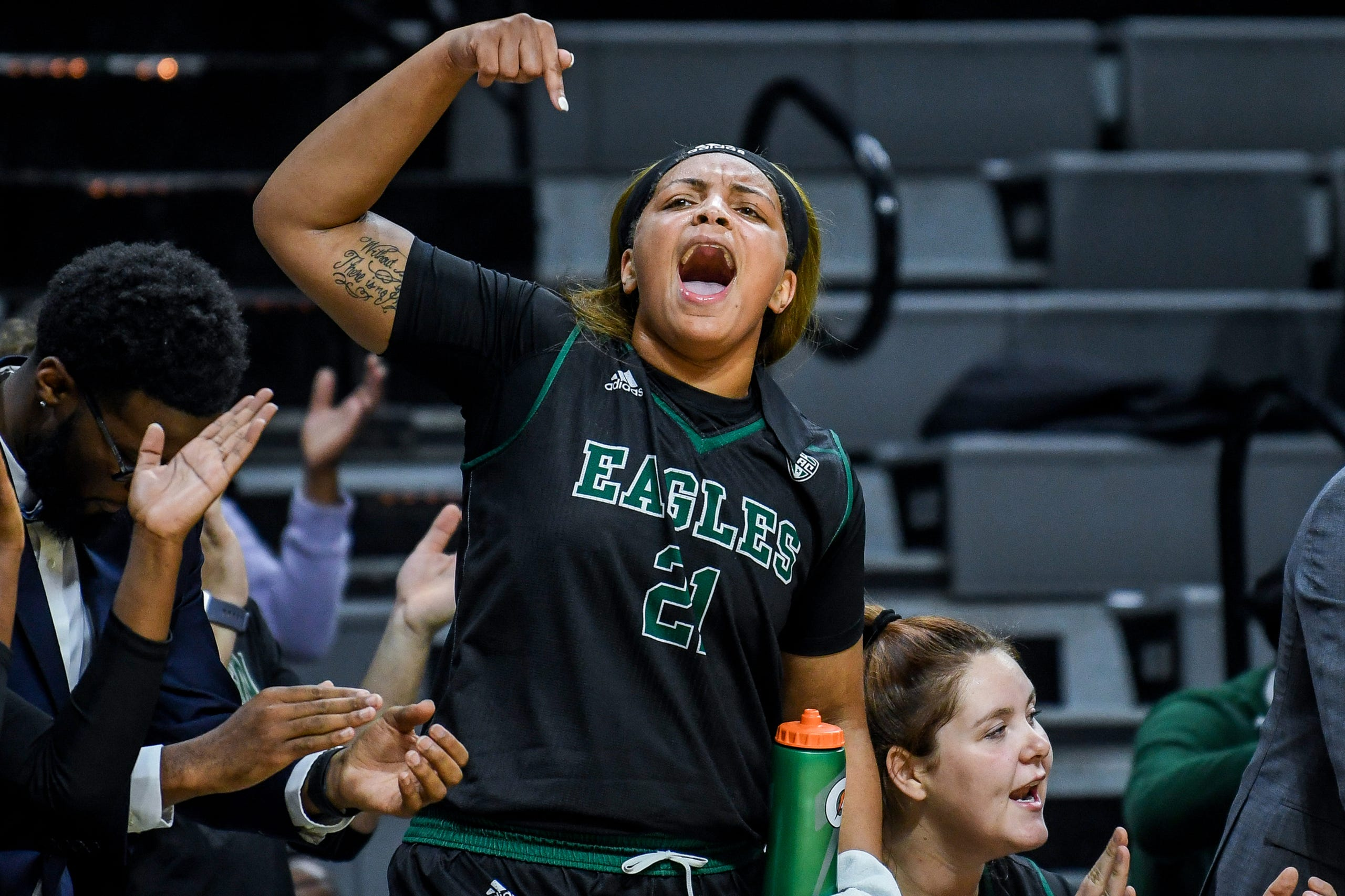 Eastern Michigan's Kiara Johnson celebrates on the bench during the second quarter on Tuesday, Nov. 5, 2019, at the Breslin Center in East Lansing.