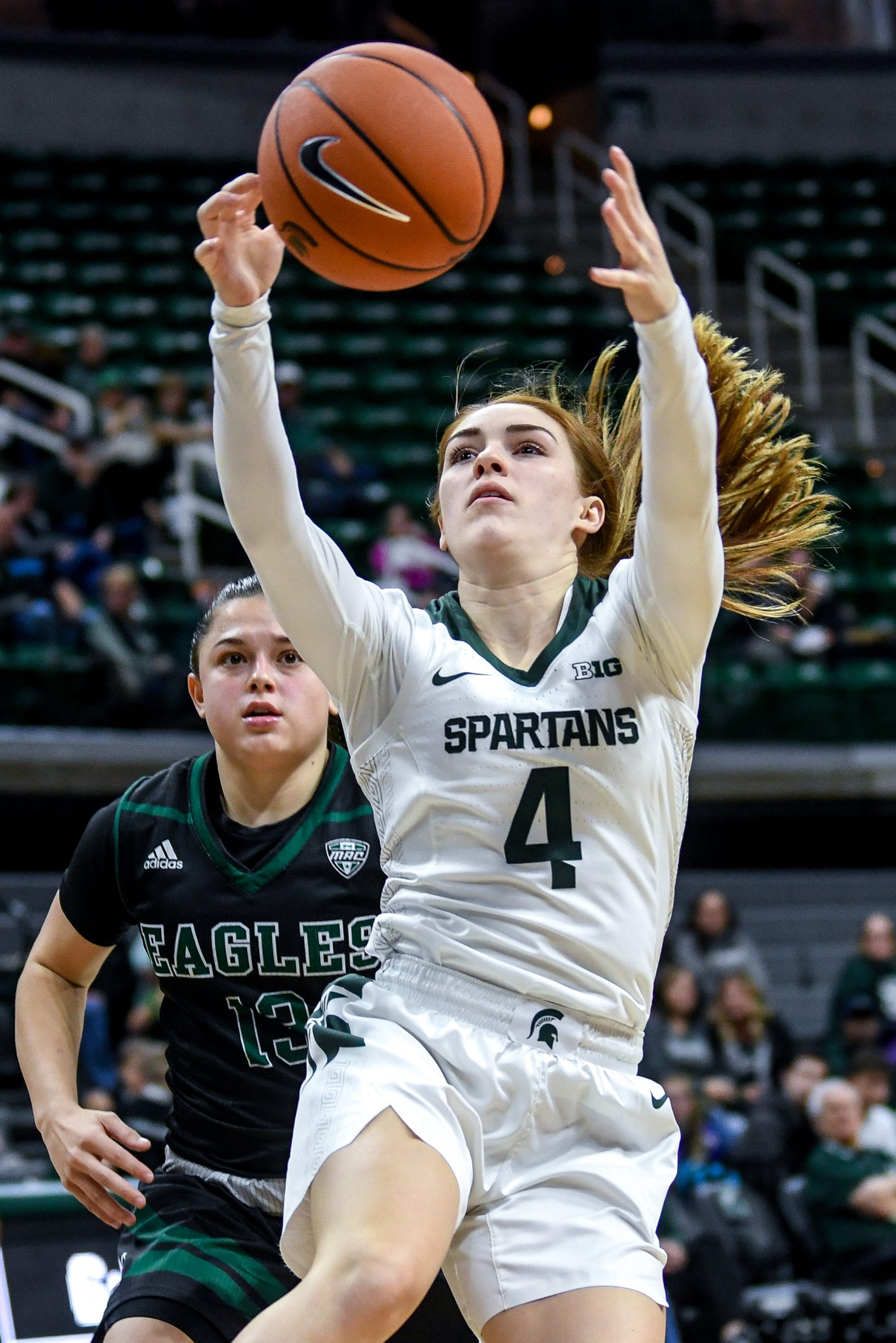 Michigan State's Taryn McCutcheon grabs a rebound as Eastern Michigan's Jenna Annecchiarico looks on during the fourth quarter on Tuesday, Nov. 5, 2019, at the Breslin Center in East Lansing.