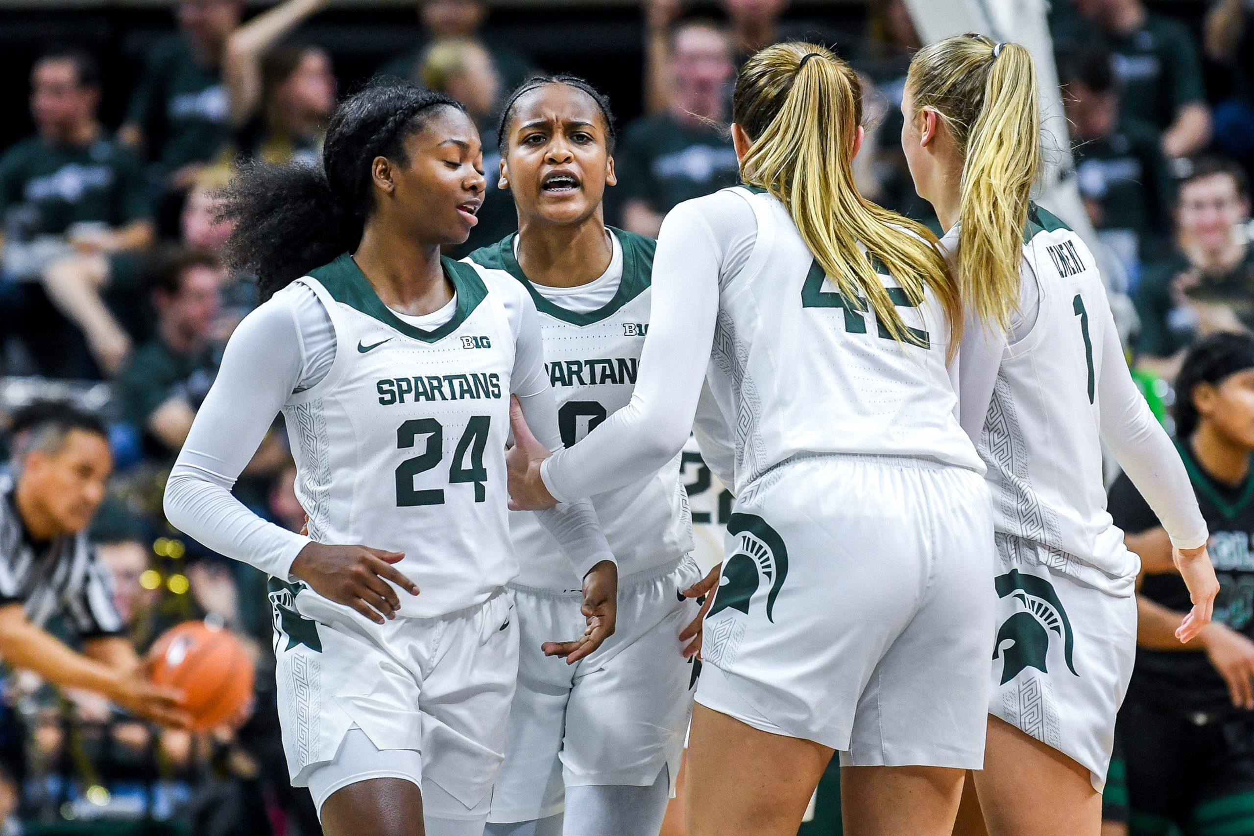 From left, Michigan State's Nia Clouden, Shay Colley, Kayla Belles and Tory Ozment celebrate after taking the lead against Eastern Michigan during the second quarter on Tuesday, Nov. 5, 2019, at the Breslin Center in East Lansing.
