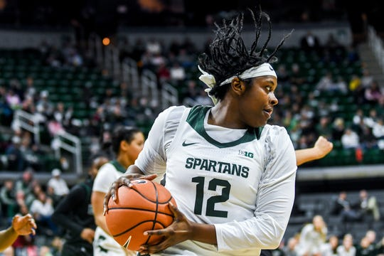 Michigan State's Nia Hollie grabs a rebound during the first quarter on Tuesday, Nov. 5, 2019, at the Breslin Center in East Lansing.