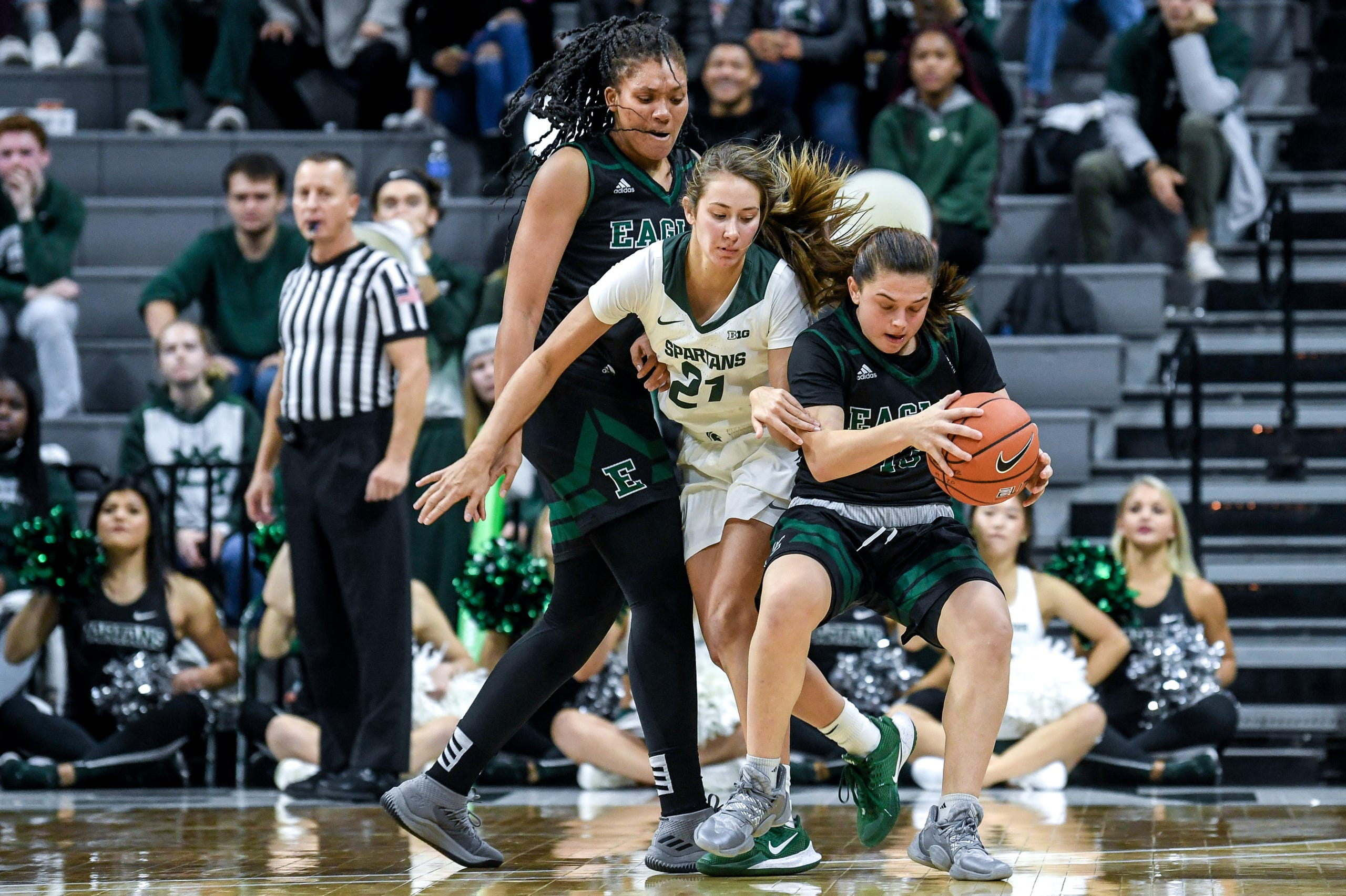 Michigan State's Laurel Jacqmain, center, pressures Eastern Michigan's Jenna Annecchiarico, right, during the  fourth quarter on Tuesday, Nov. 5, 2019, at the Breslin Center in East Lansing.