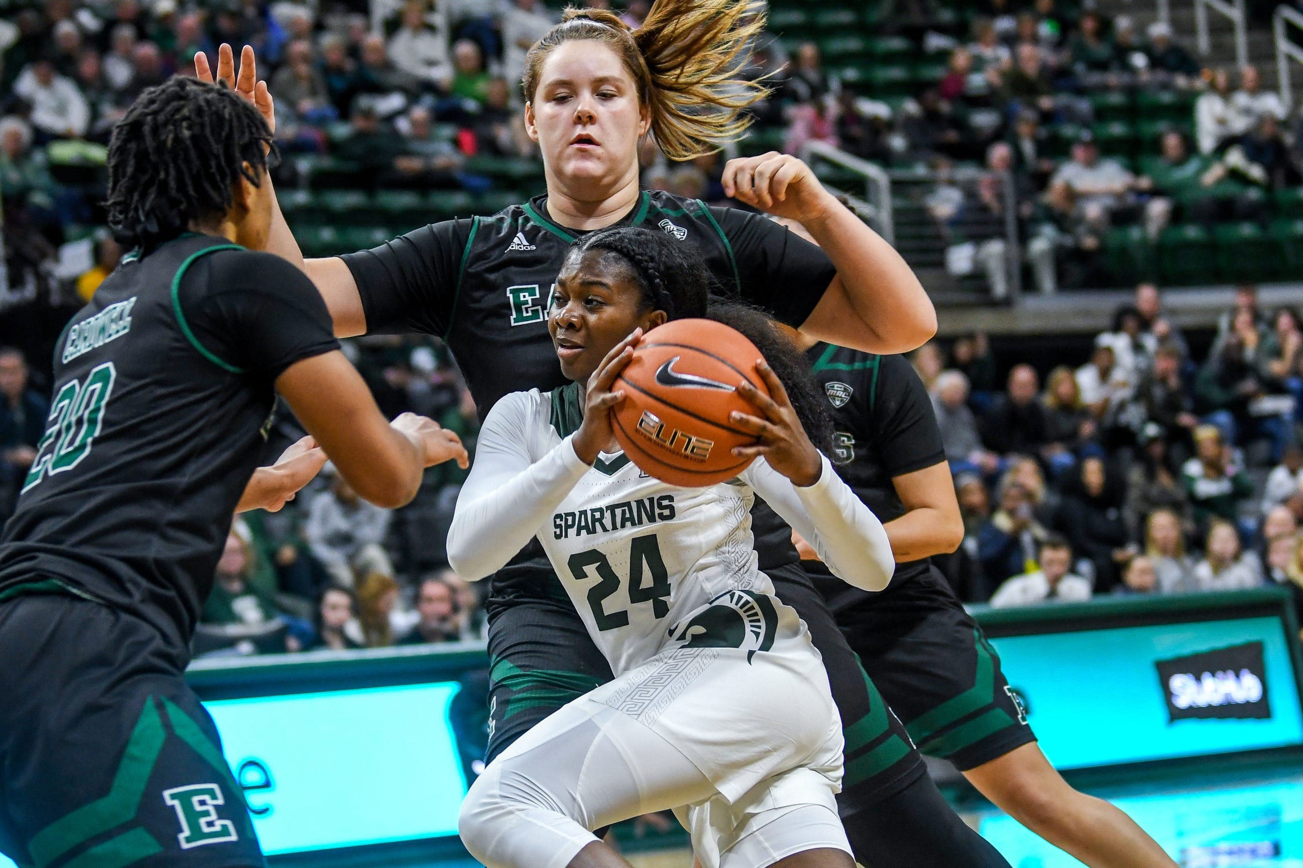 Michigan State's Nia Clouden, center, drives to the basket as Eastern Michigan's Autumn Hudson defends during the  first quarter on Tuesday, Nov. 5, 2019, at the Breslin Center in East Lansing.