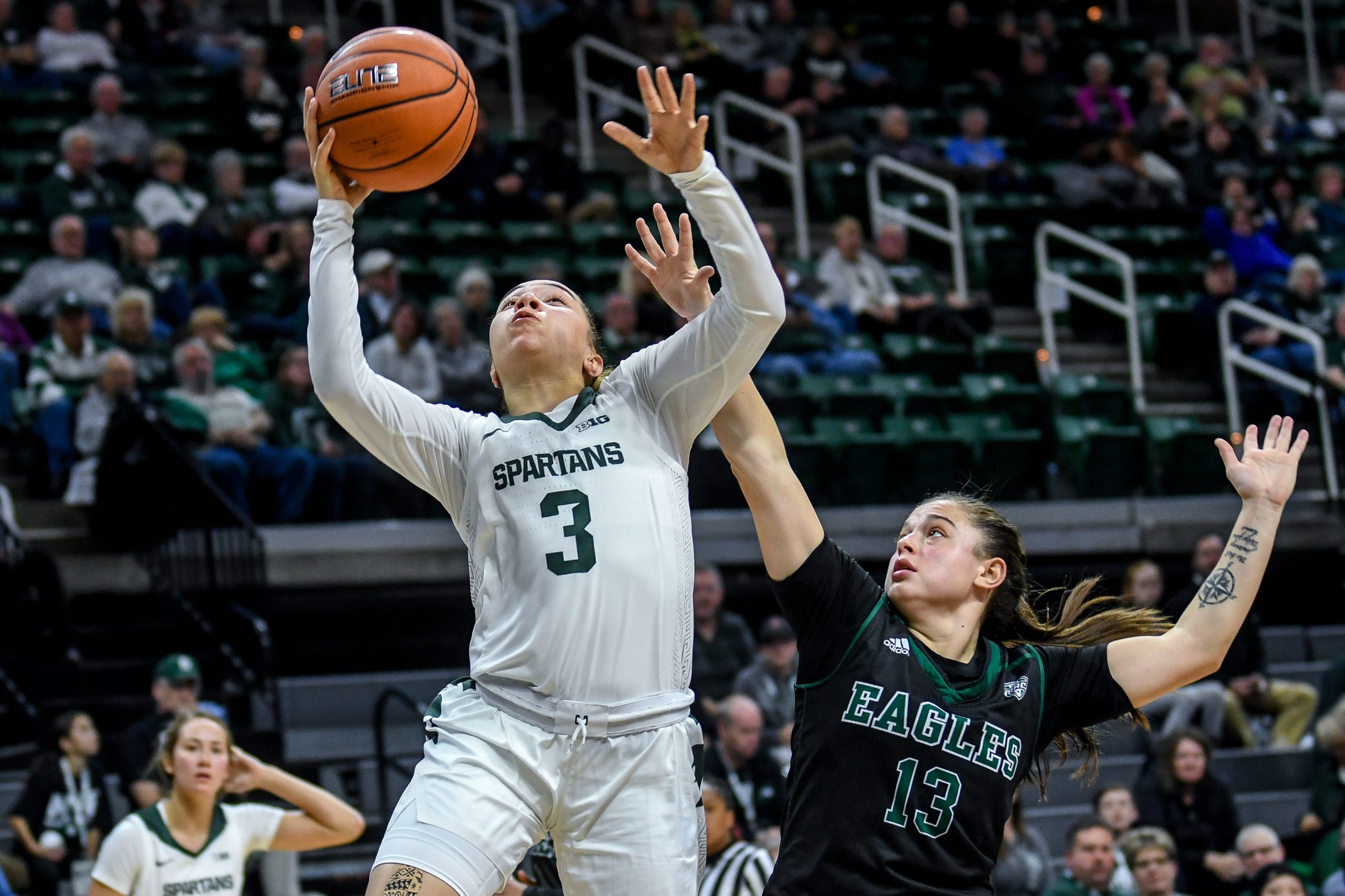 Michigan State's Alyza Winston, left, shoots as Eastern Michigan's Jenna Annecchiarico defends during the  fourth quarter on Tuesday, Nov. 5, 2019, at the Breslin Center in East Lansing.