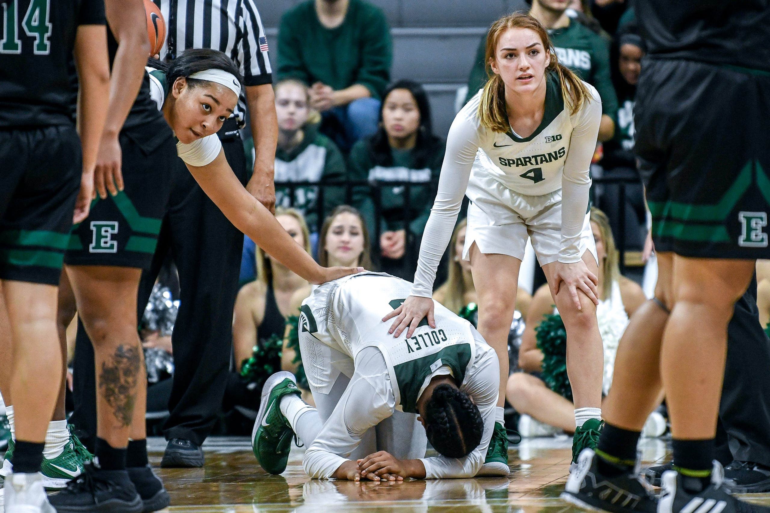Michigan State's Taiyier Parks, left, and Taryn McCutcheon, right, comfort teammate Shay Colley, center, after Colley was injured during the fourth quarter on Tuesday, Nov. 5, 2019, at the Breslin Center in East Lansing.