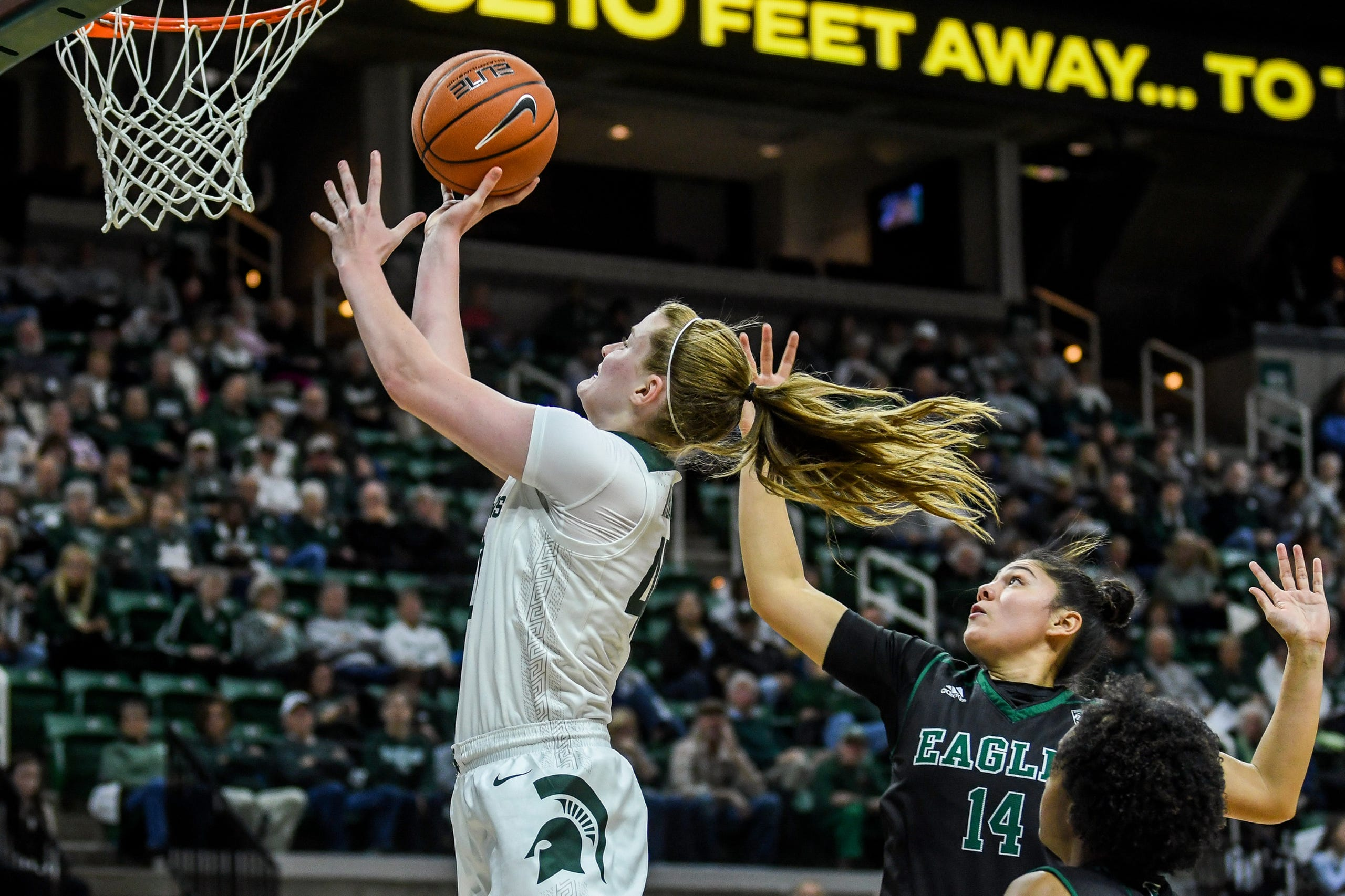 Michigan State's Julia Ayrault, left, scores as Eastern Michigan's Natalia Pineda defends during the second quarter on Tuesday, Nov. 5, 2019, at the Breslin Center in East Lansing.