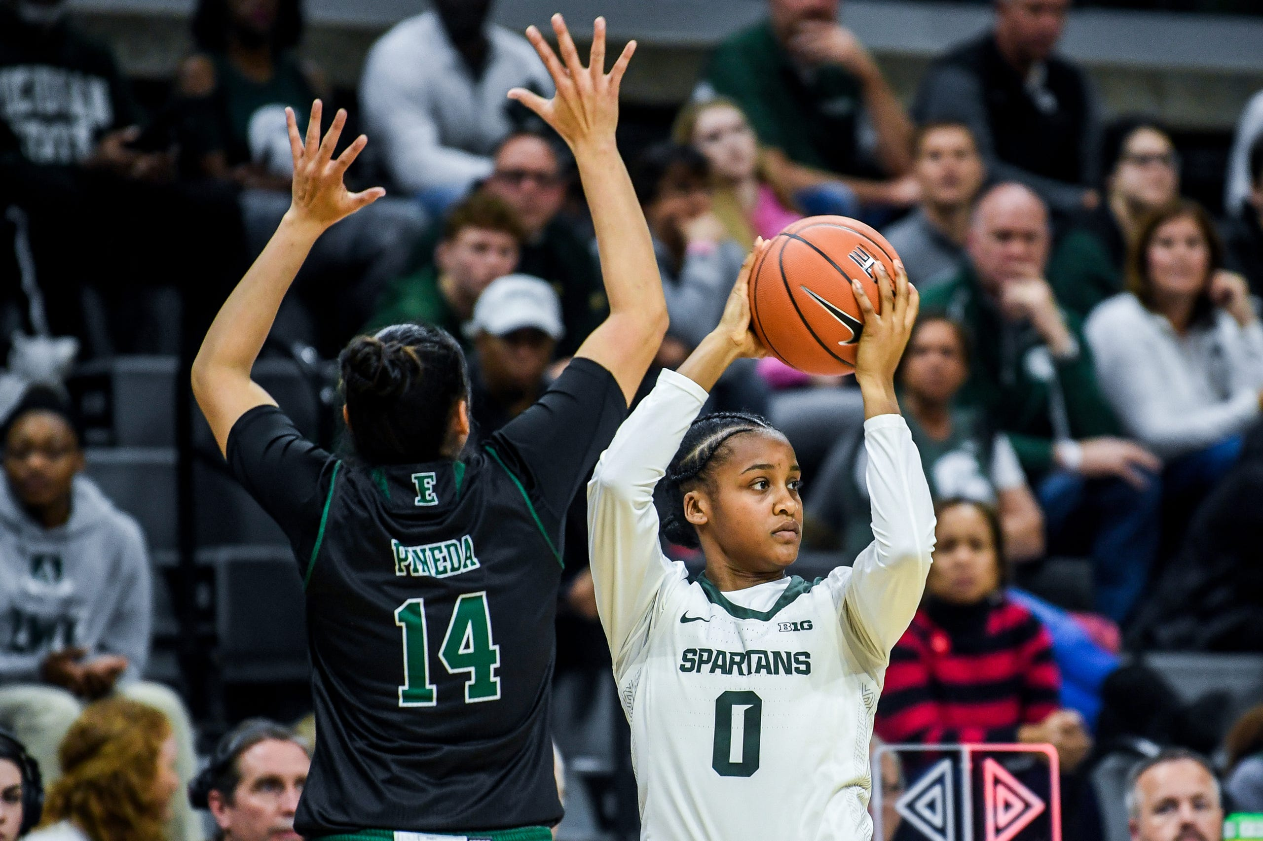 Michigan State's Shay Colley, right, looks to pass as Eastern Michigan's Natalia Pineda defends during the second quarter on Tuesday, Nov. 5, 2019, at the Breslin Center in East Lansing.
