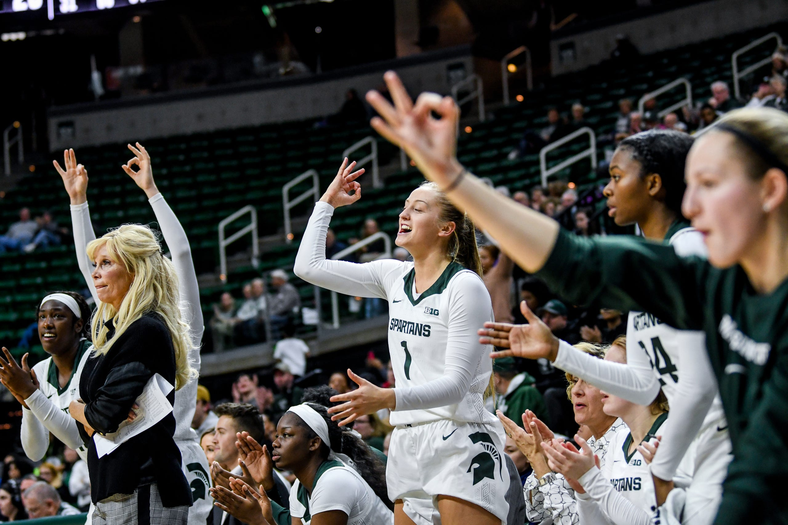 Michigan State's bench reacts after teammate Alyza Winston makes a 3-pointer during the third quarter on Tuesday, Nov. 5, 2019, at the Breslin Center in East Lansing.