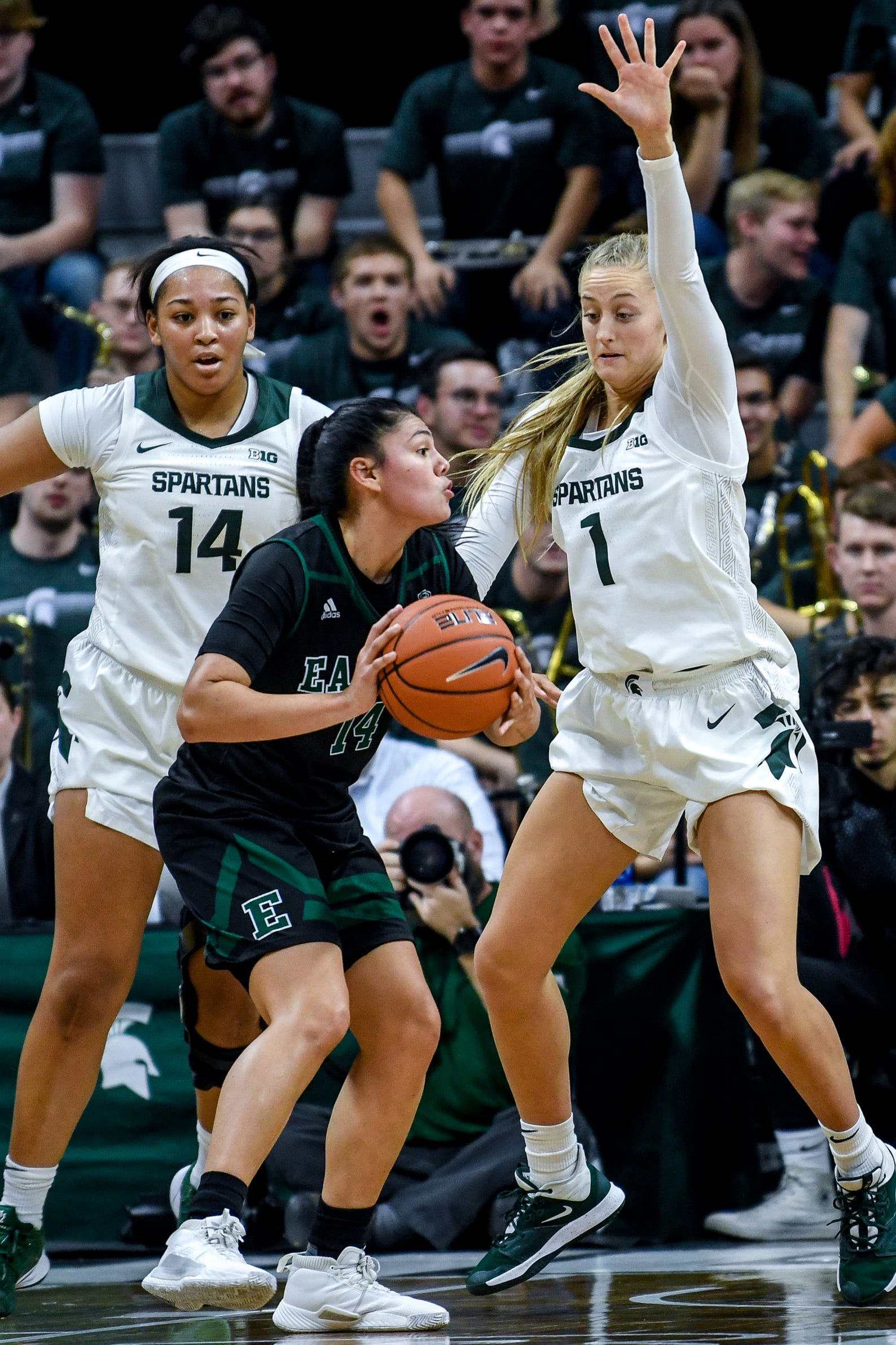 Michigan State's Taiyier Parks, left, and Tory Ozment, right, pressure Eastern Michigan's Natalia Pineda during the  fourth quarter on Tuesday, Nov. 5, 2019, at the Breslin Center in East Lansing.