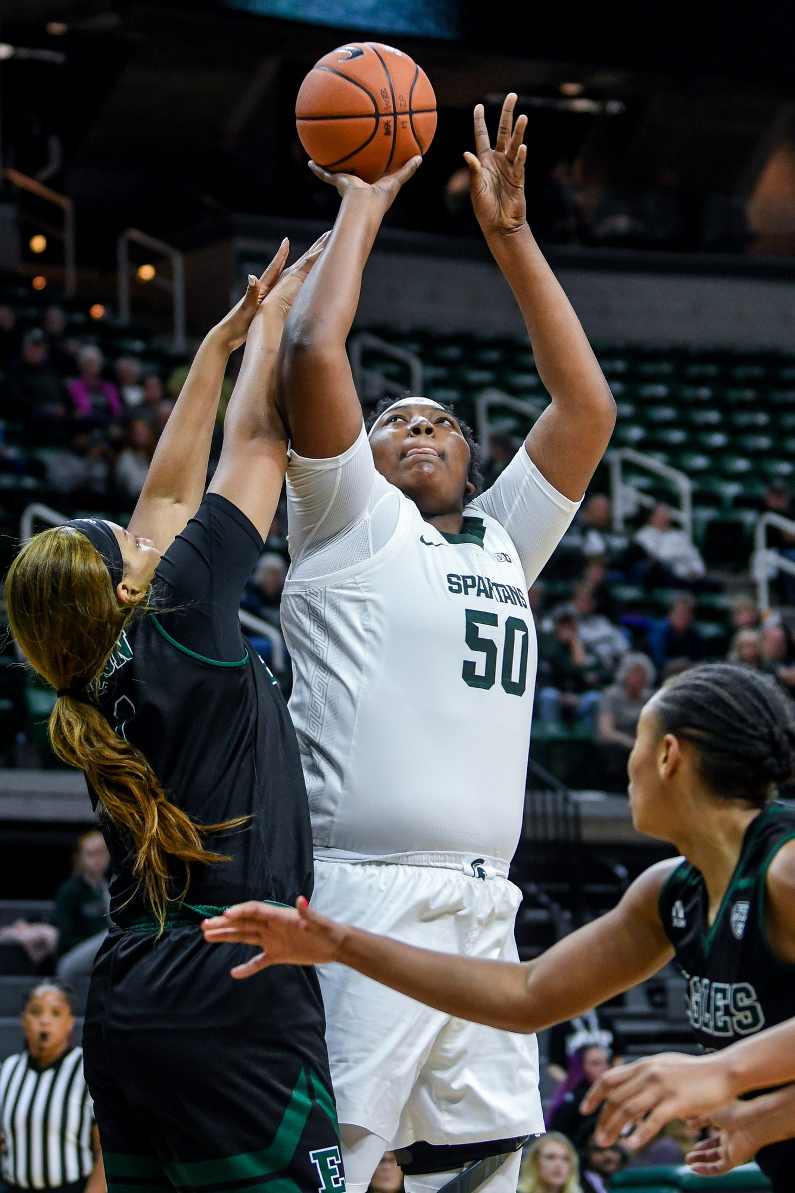 Michigan State's Cydni Dodd, right, shoots as Eastern Michigan's Kiara Johnson defends during the  fourth quarter on Tuesday, Nov. 5, 2019, at the Breslin Center in East Lansing.
