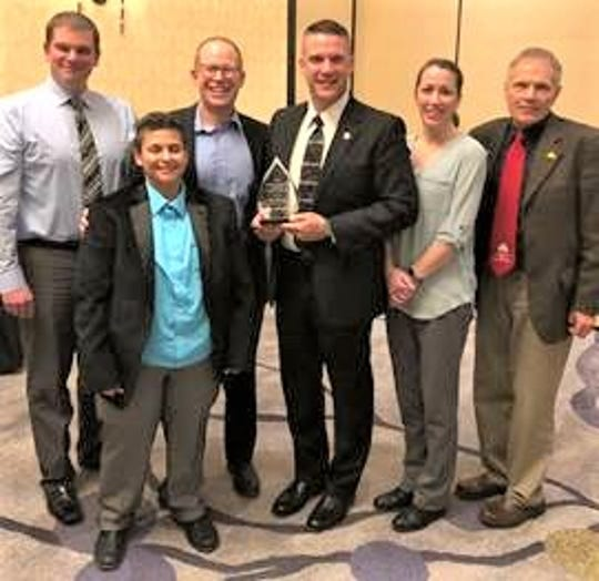 Celebrating Dan Hartwig's Distinguished Alumni Award are, from left, LTC Dean of Public Safety and Energy Ryan Skabroud, LTC District Board Vice Chair Lois Vasquez, LTC President Dr. Paul Carlsen, Dan Hartwig, Tressie Hartwigand LTC District Board Member John Lukas.