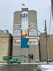 Briess Malt & Ingredients Co. has begun work to install new vinyl covering in place of the iconic Budweiser murals on its silos near Eighth and Washington streets in downtown Manitowoc, shown here on Wednesday, Nov. 6, 2019.