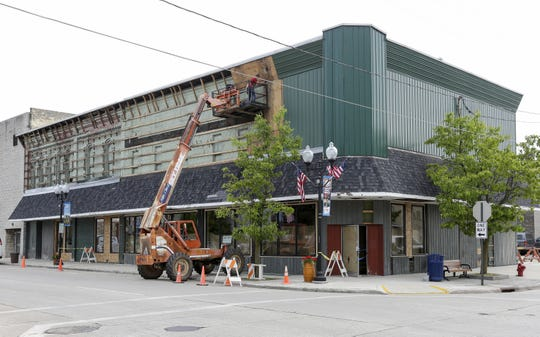 Workers tear down the facade of the future Pizza Garden location on the north 300 block of Eighth Street June 20, 2019, in Manitowoc. The facade is being restored to its original state by the restaurant owners and the city.
