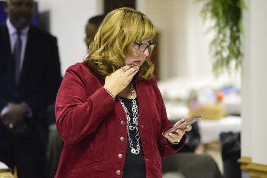 Cheryl Meier keeps track of election results Tuesday night at the Richland County Democratic Headquarters. Meier defeated Jason Crundwell, a Republican, by a margin of 1,048 votes to 860 to win the Mansfield's second-ward council seat.