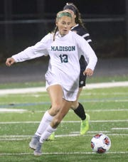 Madison's Taylor Huff dribbles down the field during the Lady Rams' 1-0 state semifinal win over Chagrin Falls on Tuesday.