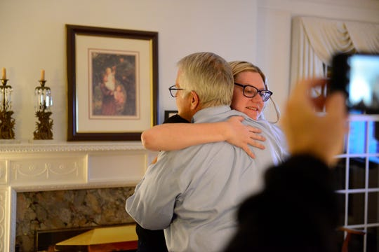 Mansfield Mayor Tim Theaker hugs Stephanie Zader, a Republican who ran for the city council's sixth ward, after unofficial election results showed that he had been elected to a third term on Nov. 5.