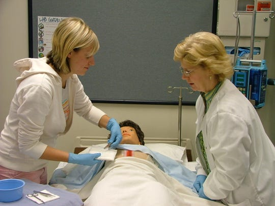 Cindy Hartman, right, MTC's Director of Nursing Technologies, helps students learn through multiple options of hands-on training.