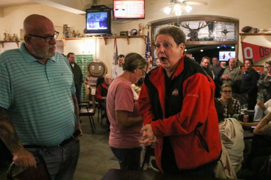 Debbie Blevins listens to the election results on the radio at the Democrats' watch party Tuesday evening. Blevins, a longtime Marion City Council member, lost her bid for re-election to challenger Joshua Feliciano, a Republican.