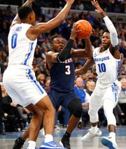 Memphis Tigers forward D.J. Jeffries, left, and Damion Baugh defend South Carolina State Bulldogs guard Rayshawn Neal on Tuesday.