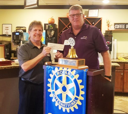 Marco Island's Sunrise Rotary Club donated $5,000 to Marco Meals of Hope at its breakfast meeting on Nov. 5. Tom Mann presented local attorney Bill Morris with the check fulfilling the club's pledge in support of Meals of Hope.