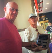Bill Reynolds, left, accepts the trophy from Bill Millhouser.