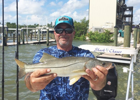 Rohman Bahar with a catch and release snook caught off Goodland.