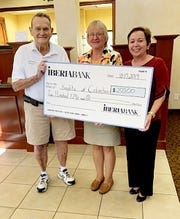 From left, SK John Bingham accepts a check from Laura Burgo, assistant branch manager, and Yvette Saco, retail marketing manager, of Iberia Bank for $250 for the Knights of Columbus Assembly 2514 Sunset Cruise for Veterans. Iberia Bank has been generous for the past several years supporting the San Marco Knights of Columbus on Marco Island and the veteran's cruise.