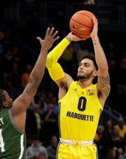Marquette  guard Markus Howard  hits a three-pointer Tuesday night against  Loyola (Maryland).