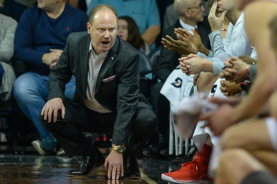 Wisconsin men's basketball coach Greg Gard talks to his players during their season opener.