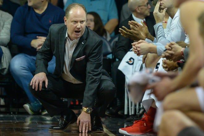 Wisconsin men's basketball coach Greg Gard talks to his players during their season opener.