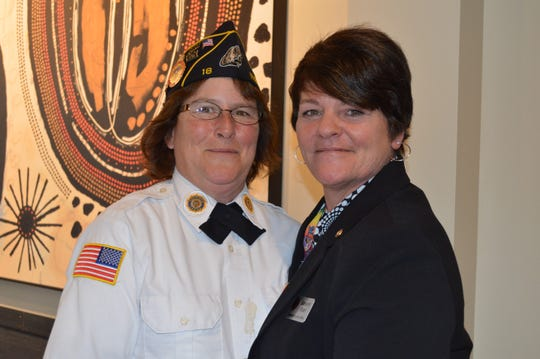 Members of American Legion Post 18, including Denise Northway (left) of West Allis, post the colors to open the Veterans for Diversity annual fundraiser. Kimberly Stuart (right) leads the nonprofit.
